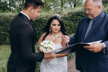 Newlyweds about to sign their paperwork while on getting married in Denmark at Lolland Island