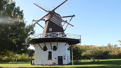 A windmill on Lolland Island, a perfect backdrop for country-style weddings abroad for your destination elopement