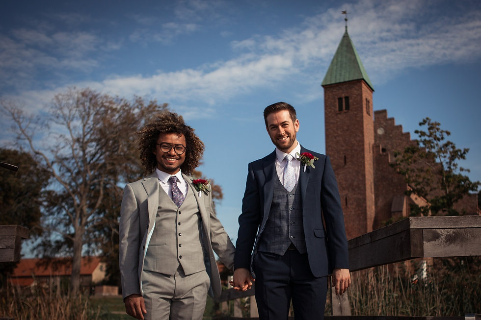 A couple during their gay marriage adventure in Denmark, pictured in Maribo in front of the Great Cathedral during their LGBT wedding.