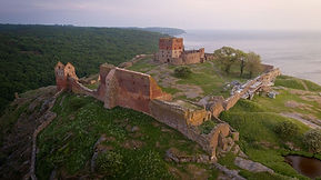 A drone-photo of the Hammershus ruins, a perfect venue for your elopement abroad