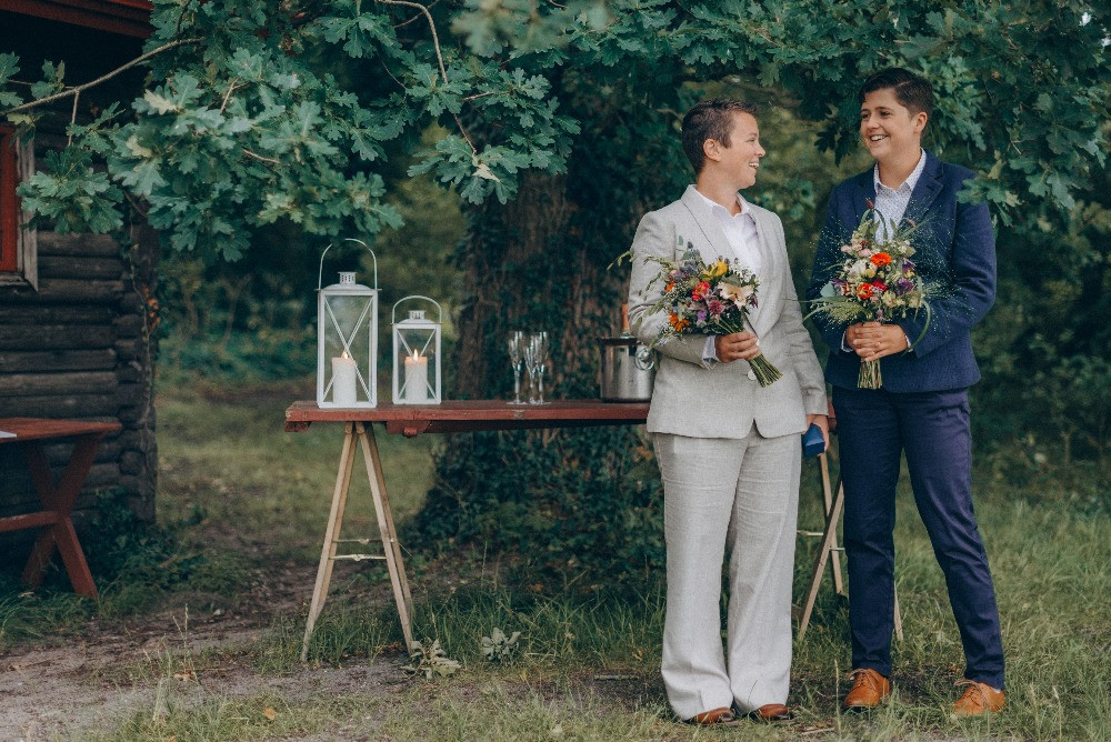 Same sex couple with flowers at their LGBT wedding in Denmark