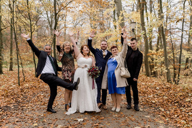A family photo in a Denmark forest in Lolland Island, one of the best places to elope abroad of intimate weddings.