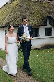 A bride and groom walking in the old village as they have their destination wedding abroad.