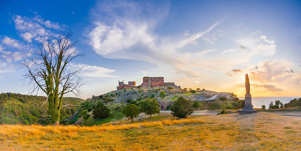 A view of Hammershus Ruins on Bornholm Island during sunset, one of the best wedding destinations in the world for your wedding abroad.
