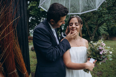 A groom caressing his bride outdoors during their Denmark wedding