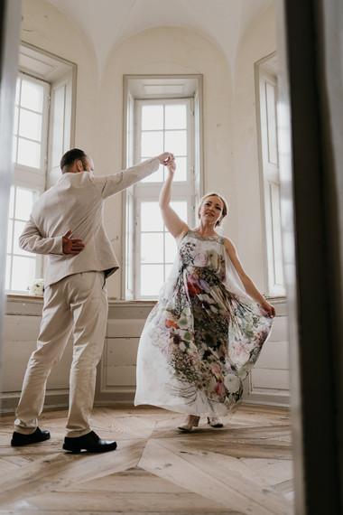 Newlyweds dancing during their castle wedding in Denmark, enjoying their Scandinavian adventure abroad.