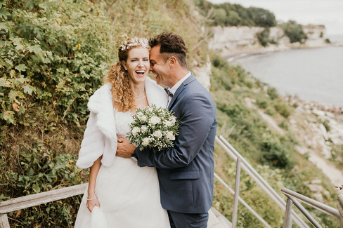 Newlyweds embracing during their small wedding abroad in Denmark, one of the best places to get married in Europe.