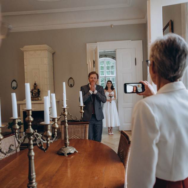 A groom showing surprise upon seeing the set-up inside the Vindeholme Castle wedding venue.