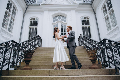 Newlyweds dancing in front of the Vindeholme Castle during their elopement in Denmark.