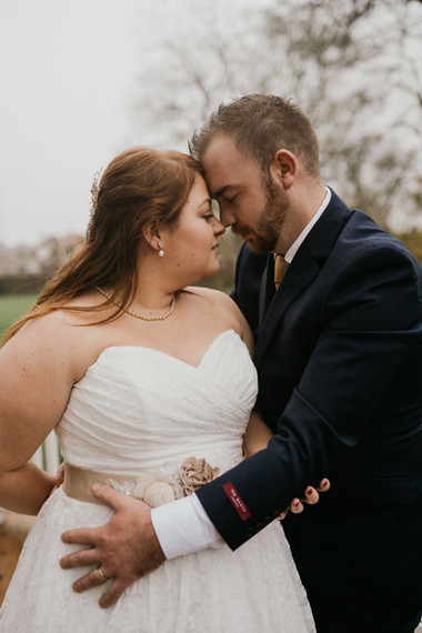 A romantic embrace between husband and wife during their wedding abroad in Denmark.