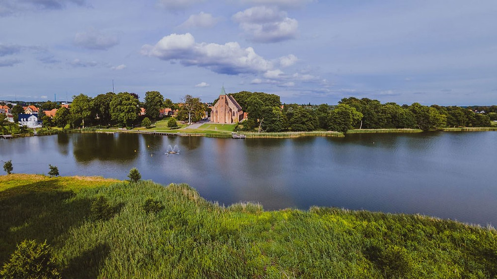 Aerial view to Maribo lake where foreign couples get married in Denmark