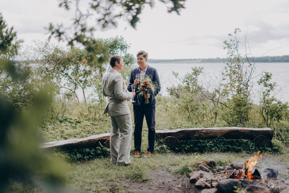 Newlyweds toasting in the forest since they just got married in Denmark