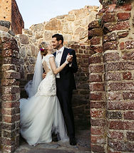 A couple dansing in the ancient ruins during their adventure elopement abroad