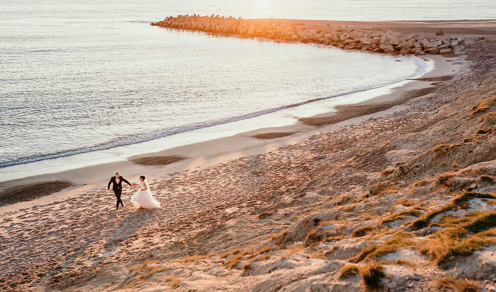 Husband and wife exploring Denmark during their beach wedding