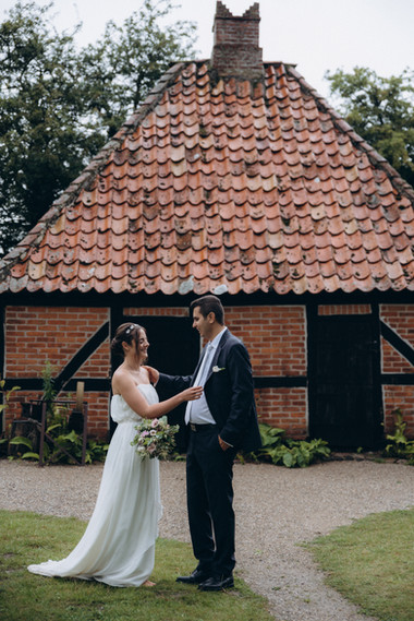A groom and bride enjoying each others company while exploring a lovely Denmark wedding venue for their country wedding.