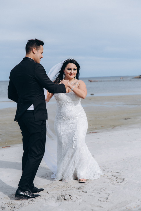 Newlyweds dancing during their Nordic beach wedding as they enjoy their adventure elopement in Denmark at Lolland Island, one of the best places to get married abroad and elope to.