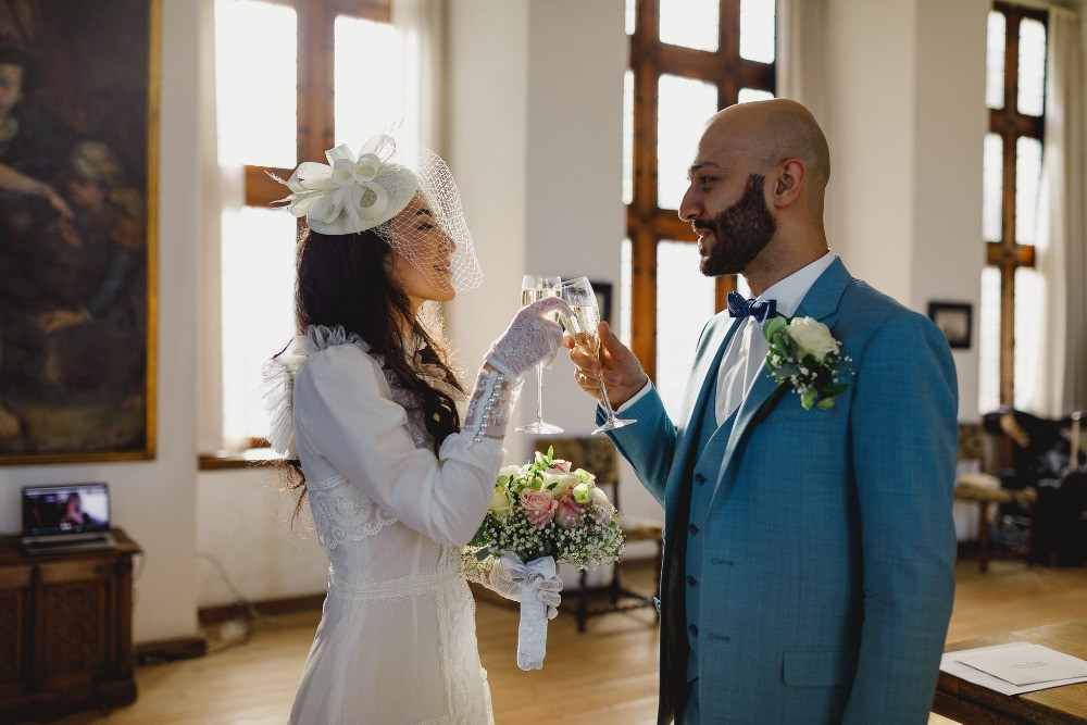 Couple toasting while they get married in the castle