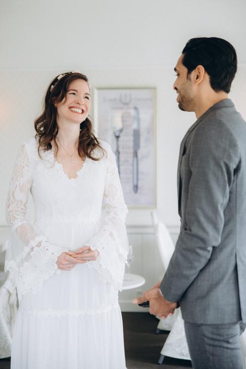 Newlyweds smiling in joy during their wedding in Denmark.