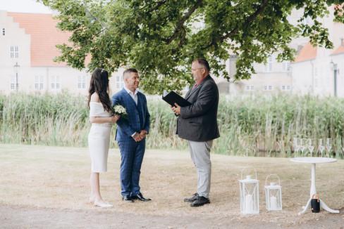 A romantic Scandinavian wedding at a castle's courtyard, a charming Denmark wedding venue on Lolland-Falster Island.
