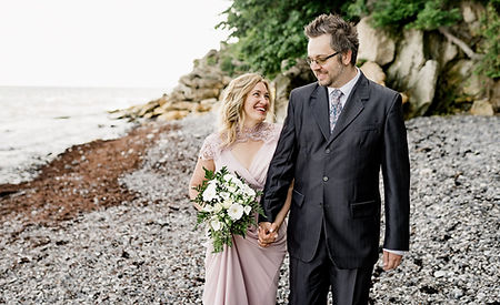 A couple enjoying their destination wedding at the UNESCO World Heritage Site Stevens Klint and the Old Hojerup Church.