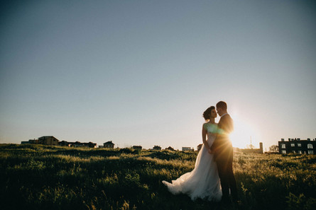 Newlyweds kissing during sunset at Møn Island as they elope abroad to Denmark for their adventure wedding abroad.