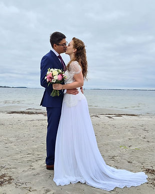 Our adventure elopement packages are ideal for couples that want to escape to Denmark, pictured a bride and groom kissing during their beach wedding. But first, collect your documents to get married in Denmark.
