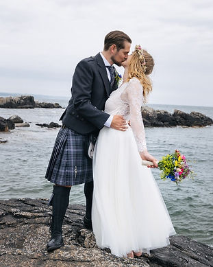 Newlyweds kissing after they get married in Denmark on Bornholm island.