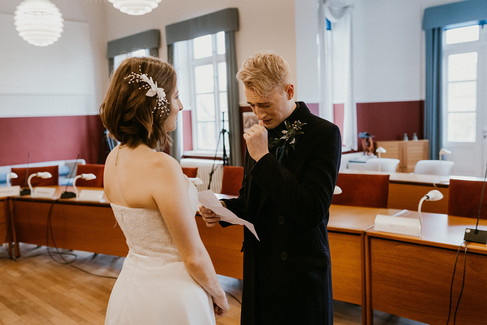 A groom being emotional during his civil marriage in a Denmark town hall.