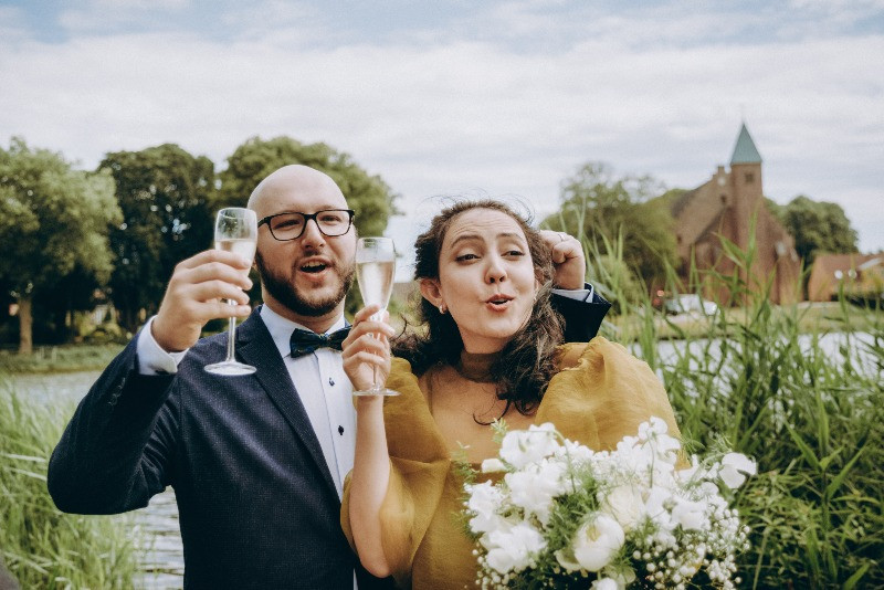 A couple toasting after their intimate elopement wedding with friends in Denmark