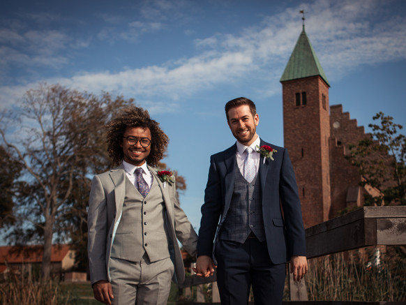 A couple eloping abroad for their gay marriage in Denmark, a country with liberal same-sex marriage laws.