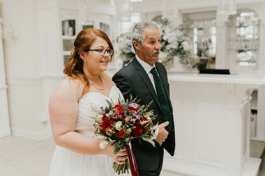 A bride walking down the aisle with her father during her small wedding abroad in Denmark.