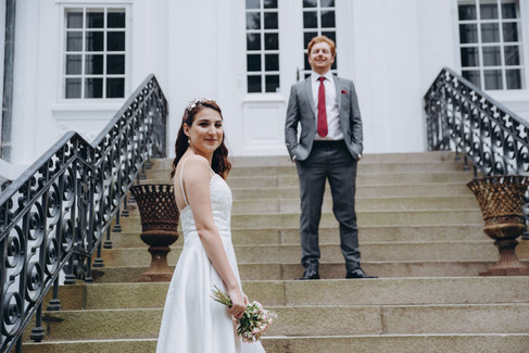 Newlyweds posing in front of the Vindeholme Castle in Denmark, their wedding abroad destination.
