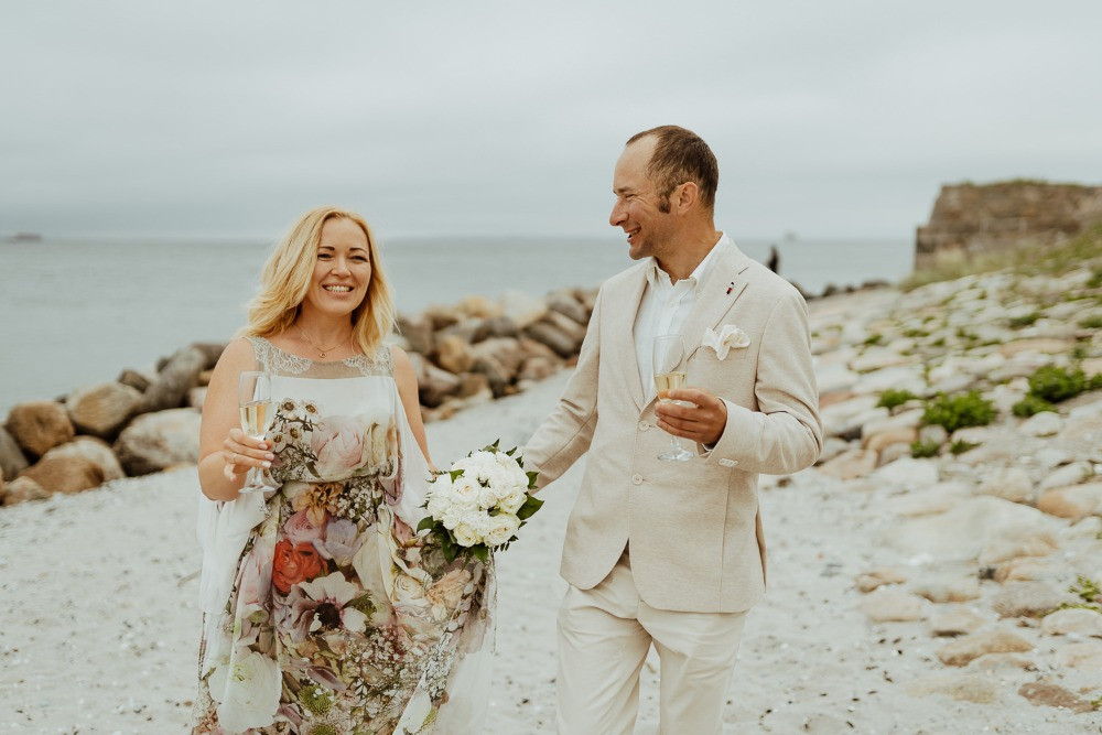 Newlyweds celebrate with champagne their marriage in Denmark