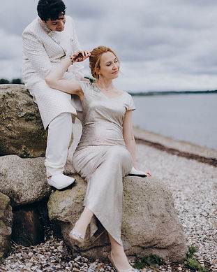 A couple sitting on the rock after their Danish island wedding