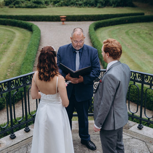 A couple standing during their small castle wedding, saying their vows at the Vindeholme Castle.