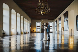 Newlyweds dancing in the balroom in Hamlet castle since they had wedding in the castle