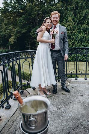 A couple at their small castle wedding venue in Denmark, enjoying their all-inclusive destination wedding.