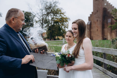 A lesbian couple receiving their marriage certificate after their LGBT wedding in Denmark at the Maribo Lake