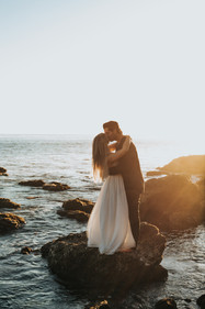 A couple kissing on the big rock