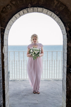 A bride during her entrance at the Old Hojerup Church on Stevens Klint, ideal for Nordic weddings in Denmark.