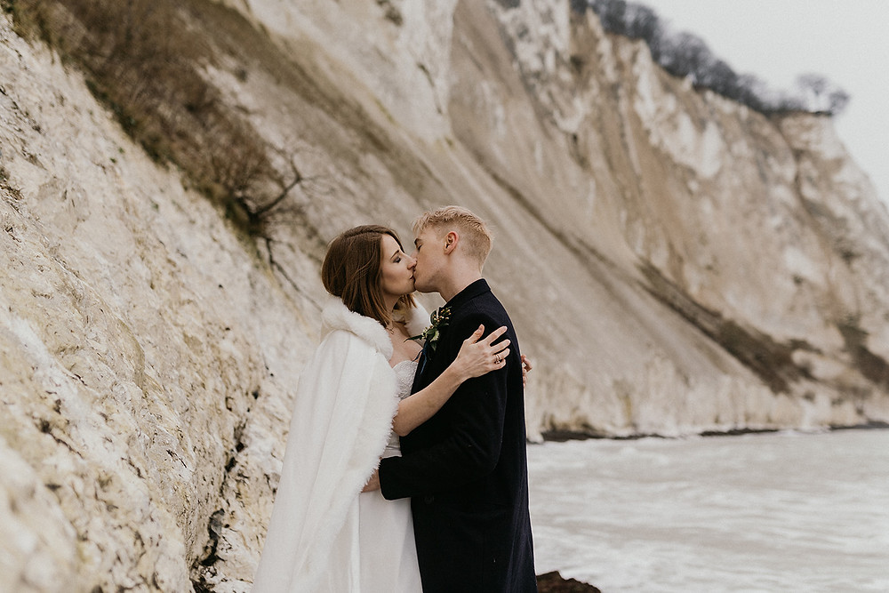 The couple kissing at the Danish cliffs at their elopement to Denmark