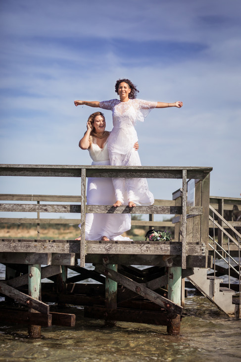 A couple reenacting a scene from the Titanic as they enjoy their LGBT wedding in Lolland Island