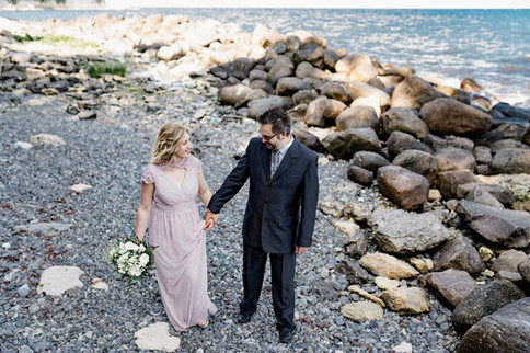 A couple enjoying themselves at Stevens Klint, one of the best places to get married abroad, during their Denmark wedding adventure.