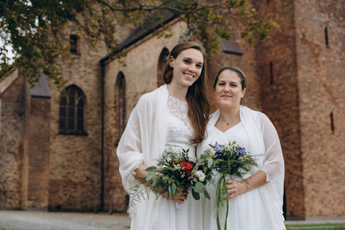An intimate moment between a lesbian couple during their LGBT wedding in Denmark, one of the best places to elope abroad for a gay marriage.