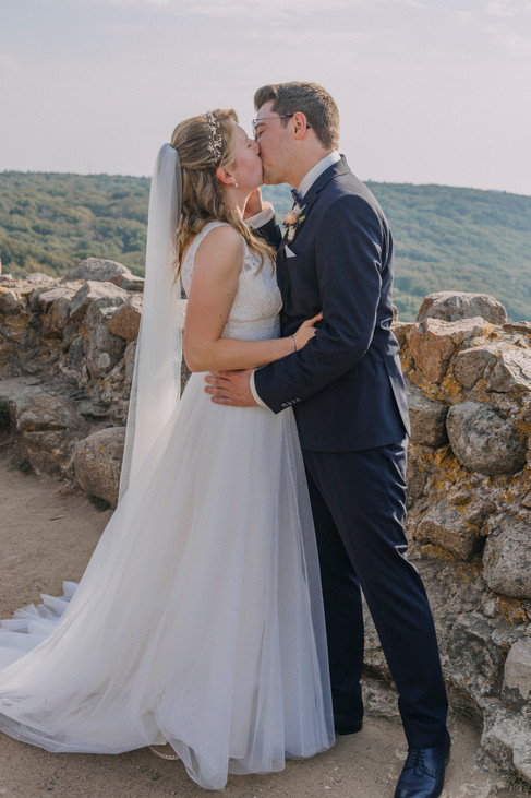 Newlyweds kissing during their adventure wedding at Bornholm Island as they enjoy their elopement in Denmark.