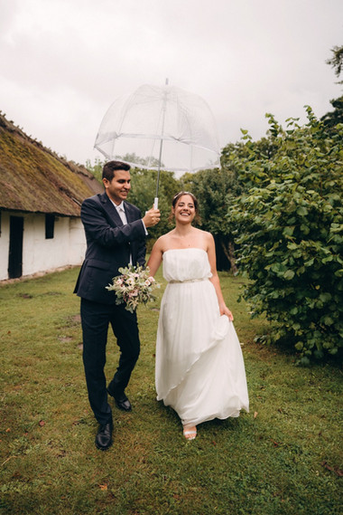 Newlyweds embracing each other during their Danish wedding adventure, a perfect opportunity if your marry abroad idea is to have a laid back experience of a Denmark wedding venue in nature.
