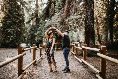 A couple dancing in the forest.