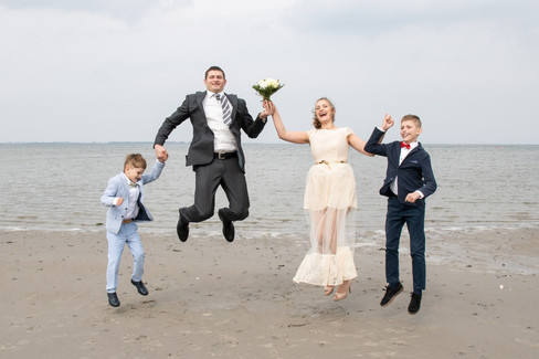 A charming family portrait during a beach wedding at Lolland Island, one of the best places to get married abroad in Denmark.