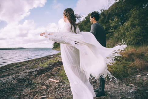 Newlyweds enjoying nature by the beach during their Nordic wedding, an all-natural Denmark wedding venue.