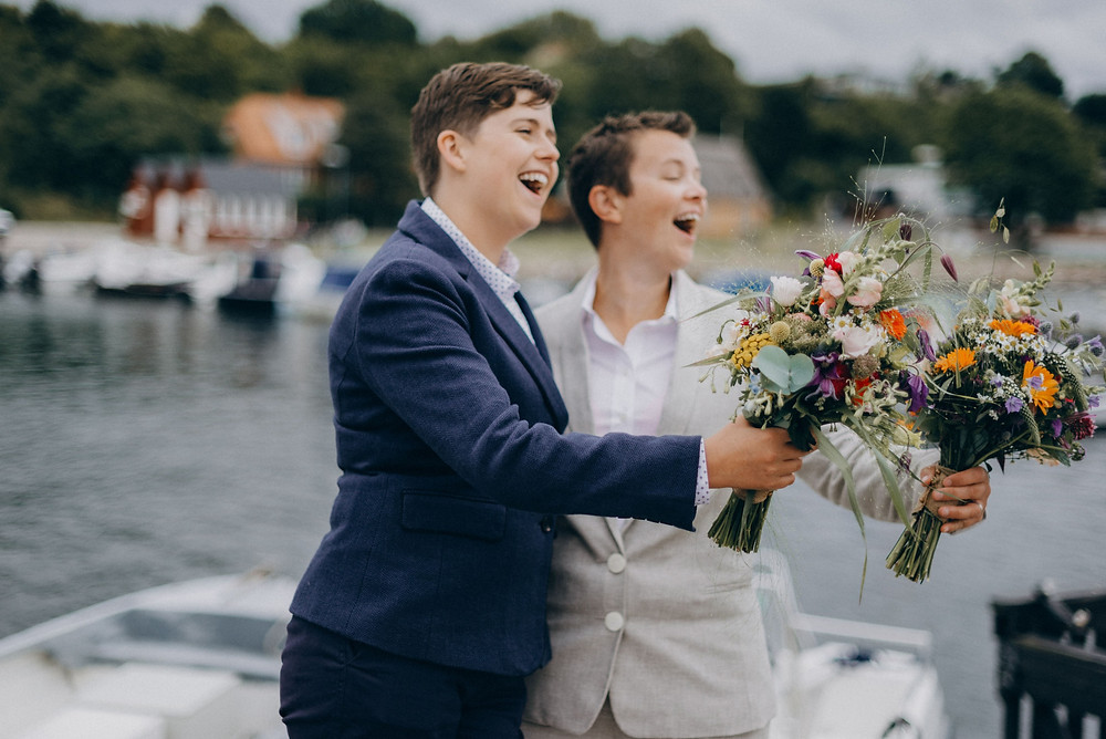 Same sex couple make fun during their elopement in Denmark